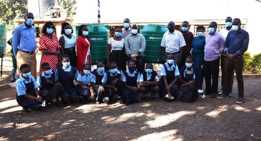 CFK Staff Providing WASH Resources to Schools