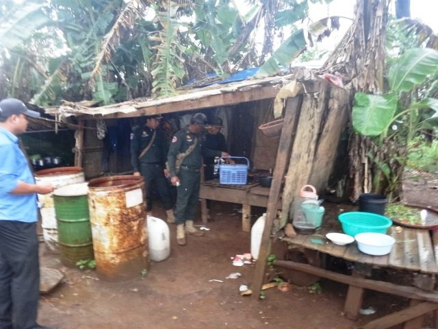 Rangers searching hut, where they noticed the bin