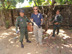 Rangers rescuing the rare Siamese Crocodile baby.
