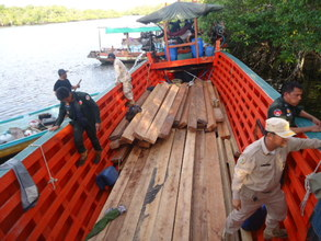 Confiscated boat with Timber
