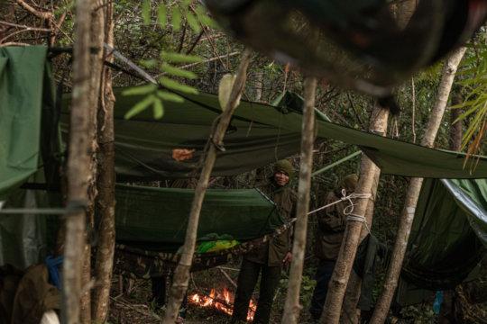 Setting up camp. Rangers may rotate night shifts.