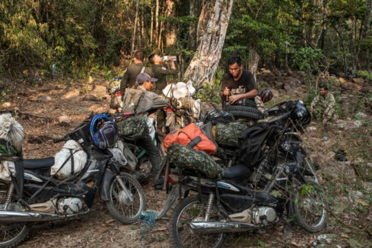 Rangers load up their motorbikes for a long patrol