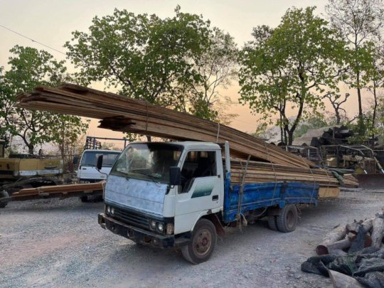 Transporting confiscated timber back to base.