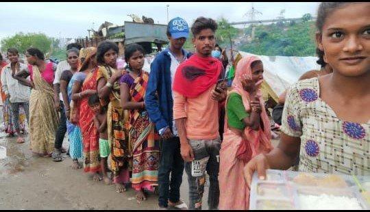 Food Distribution in nearby slum