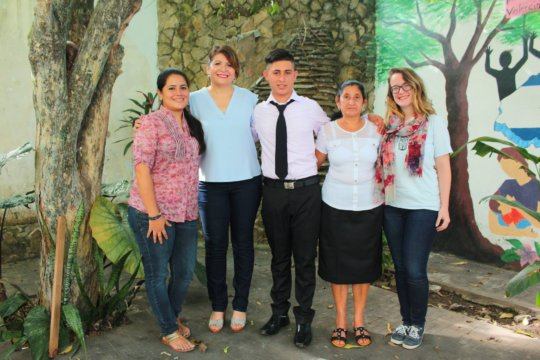 OYE staff w/ high school grad and his proud mother