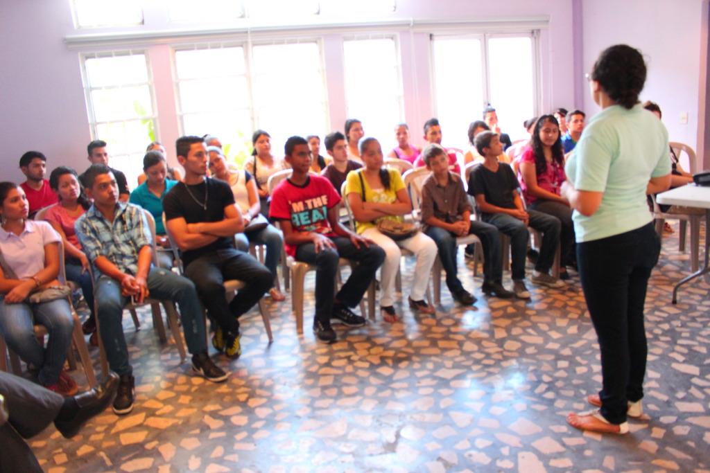 Programs Coordinator addressing aspiring scholars.