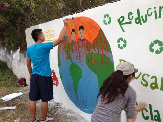 Paiting environmental mural at local school