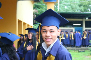 OYE scholar at high school graduation in December