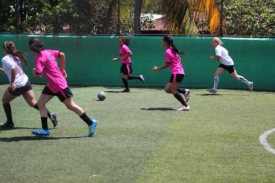 OYE girls playing soccer in Copa OYE
