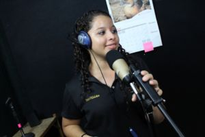 Empowered young woman Ivelis in OYE's radio booth