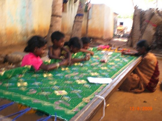 Drop-out children doing Embroidery work