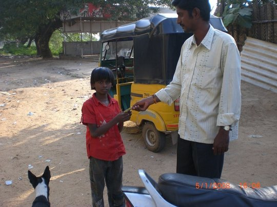 A child is asking for money on the street