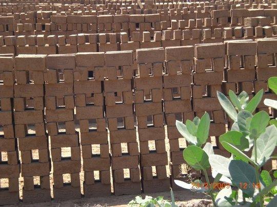 Children make bricks with parents