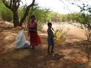Children picking rags and waste paper on the stree