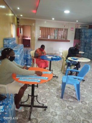 Milele purified water staff at work