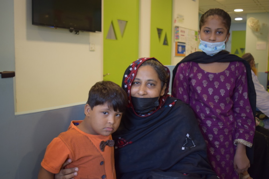 Family waiting for child's therapy session
