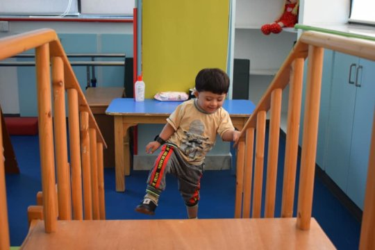 Child practicing climbing during physical therapy