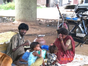 Anand kumar lives under overbridge with his family