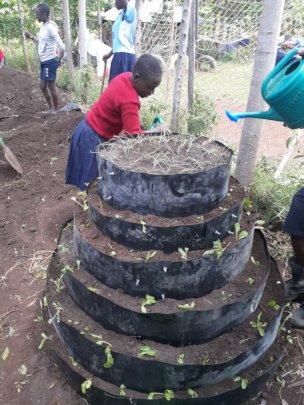 Akili girls watering veggies