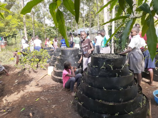 girls making multistory gardens for growing veggie