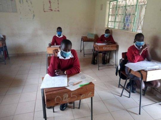 girls sitting exams