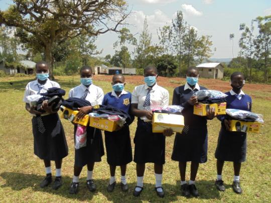 Girls receiving new school uniforms