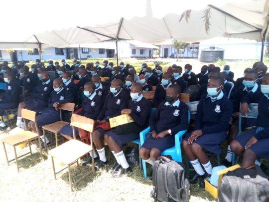 students in new school uniforms