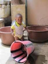 Alason knocks over the dishwashing bucket