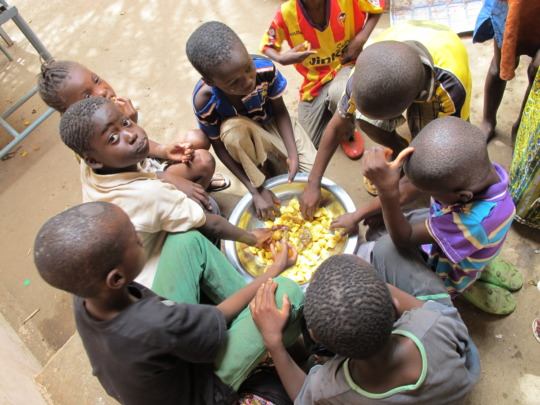 Kids sharing a meal at the clinic