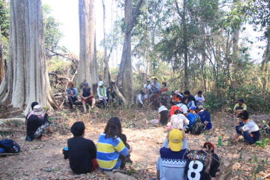 Outdoor meeting to a protecting forest