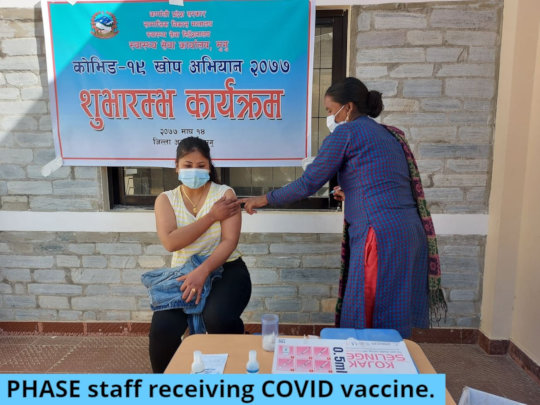 PHASE Nepal auxiliary midwife receiving vaccine