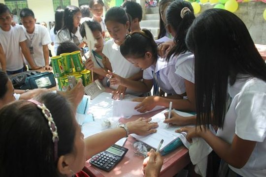 Children opening their first savings account