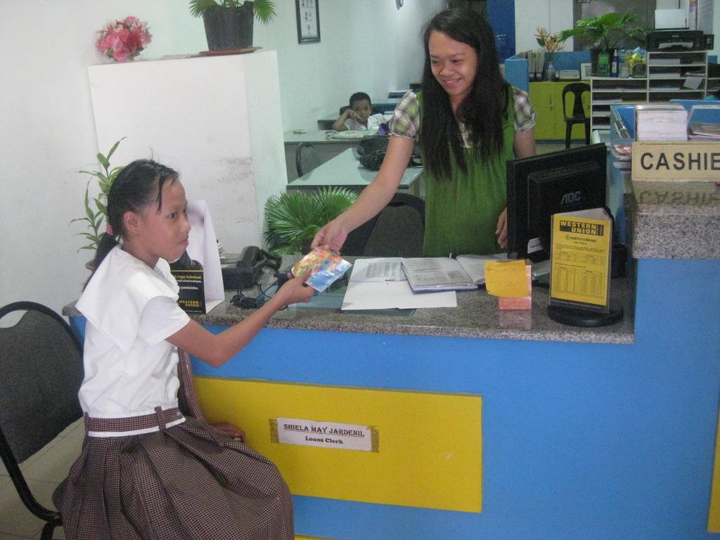 A Filipino girl depositing money