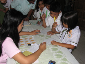 Children falling in line during their savings day.