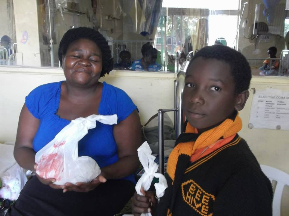 BeeHive student giving donation to patient