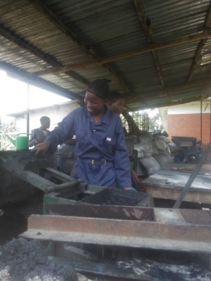 A woman undergoing training at the briquette unit