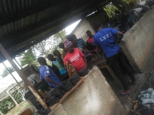 Students undergoing training at the briquette unit