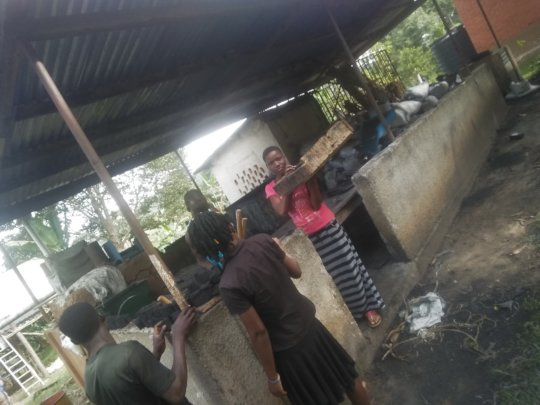The girls extruding briquettes at a session