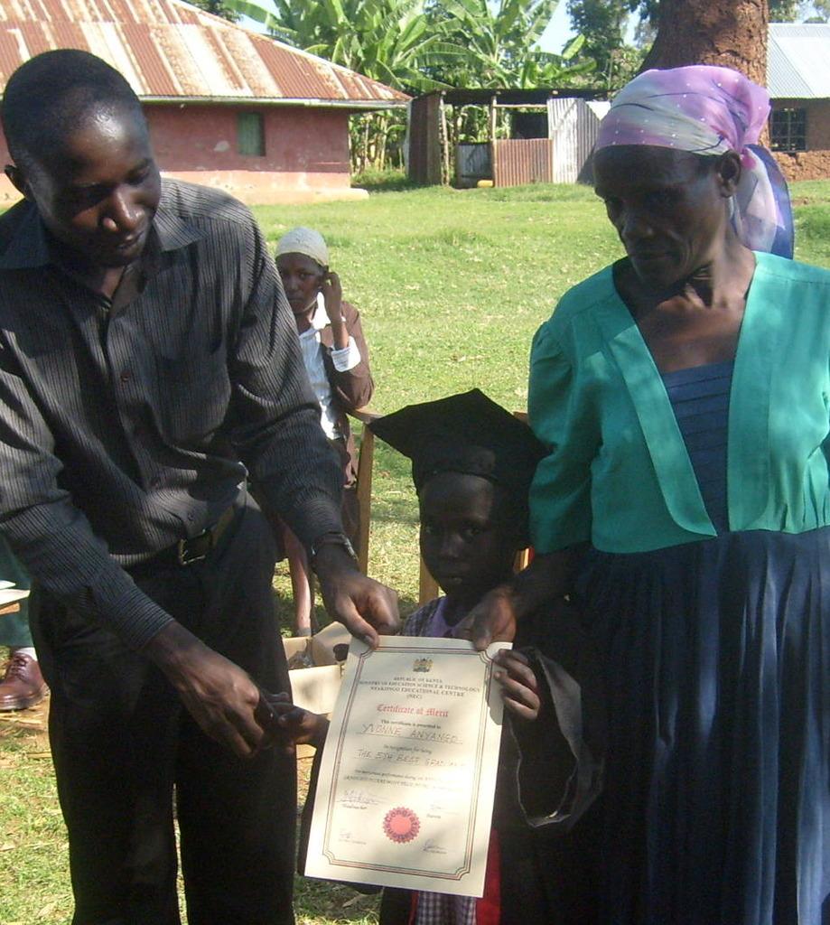 Isaac cogratulating young graduate