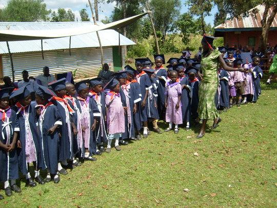 Children from new school graduating