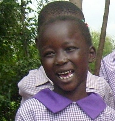 This young girl is an orphan in western Kenya, an area with high HIV rates. She is happy because, through PATHWAYS and Global Giving, her school fees are paid, she has a uniform, enough to eat, a new school building and importantly a school family. She is smiling because she has a chance to succeed.