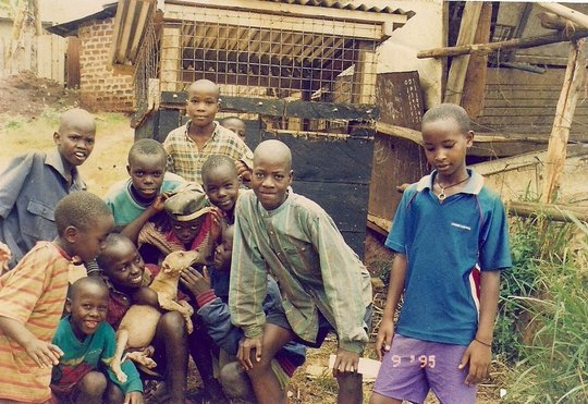 Uganda: Children w/puppy and new home from USPCA
