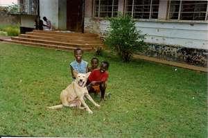 Uganda school children with Simba, humane ed dog
