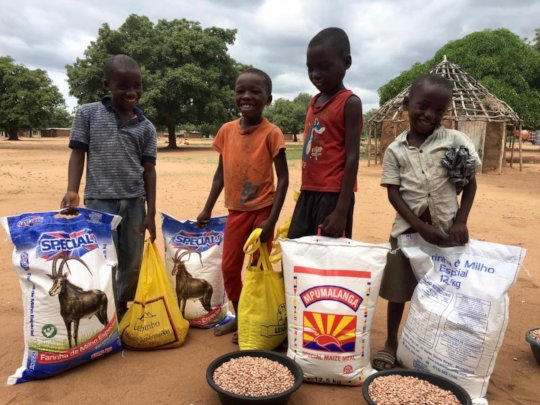 Providing food baskets to students in Mozambique