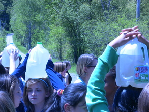 Students Walk with Water Jugs on Their Heads