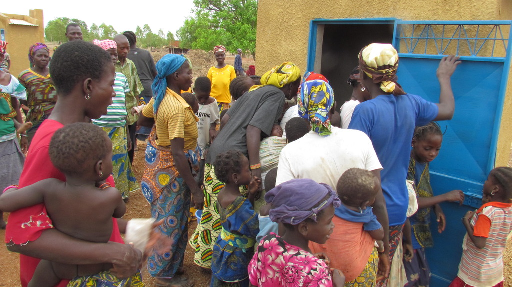 Villagers take their look at the new latrine