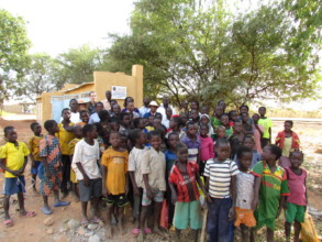 Students pose for photo in front of new latrines