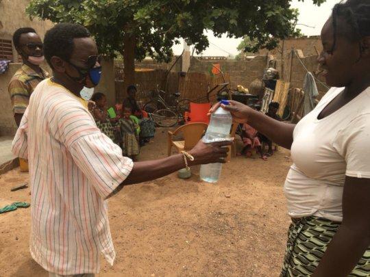 BARKA staffer delivers soap and sensitization