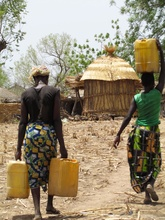 Women of Tantiaka carrying water