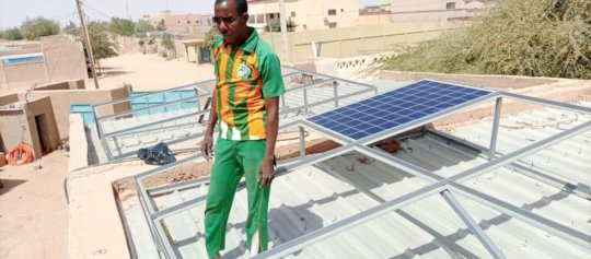 Installing solar panels at the Learning Center